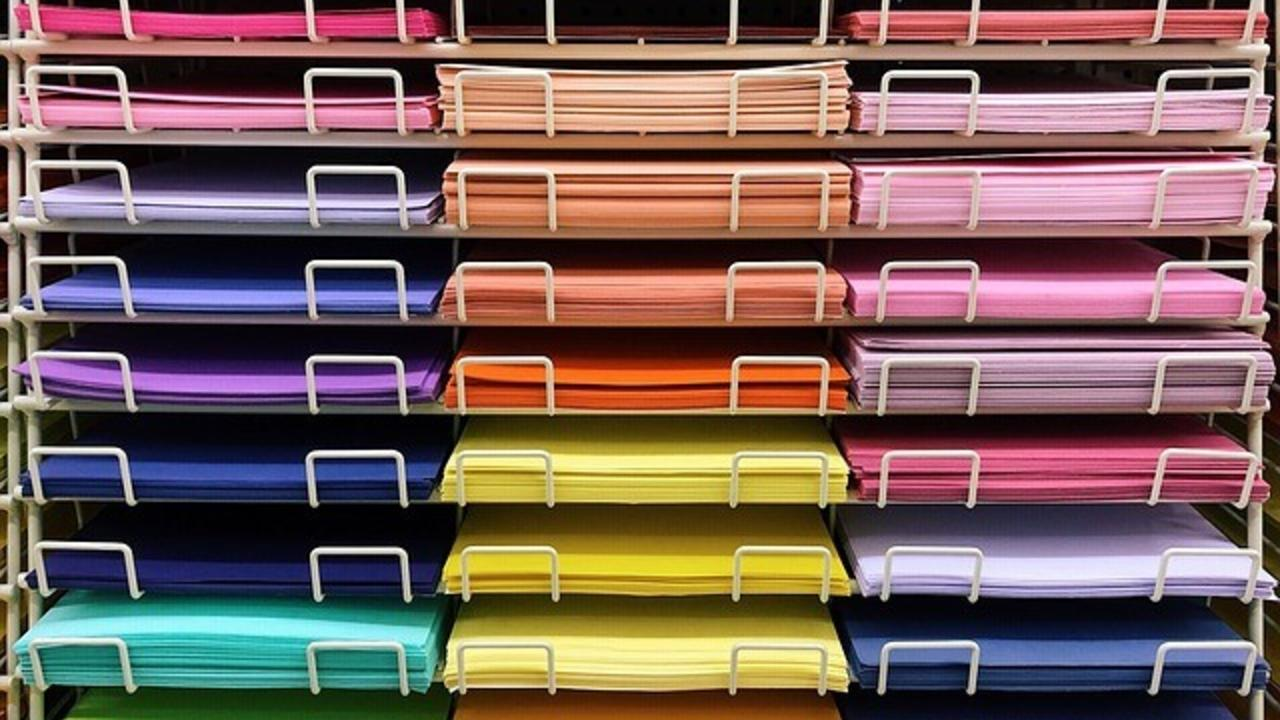 different colors of construction paper organized in slots